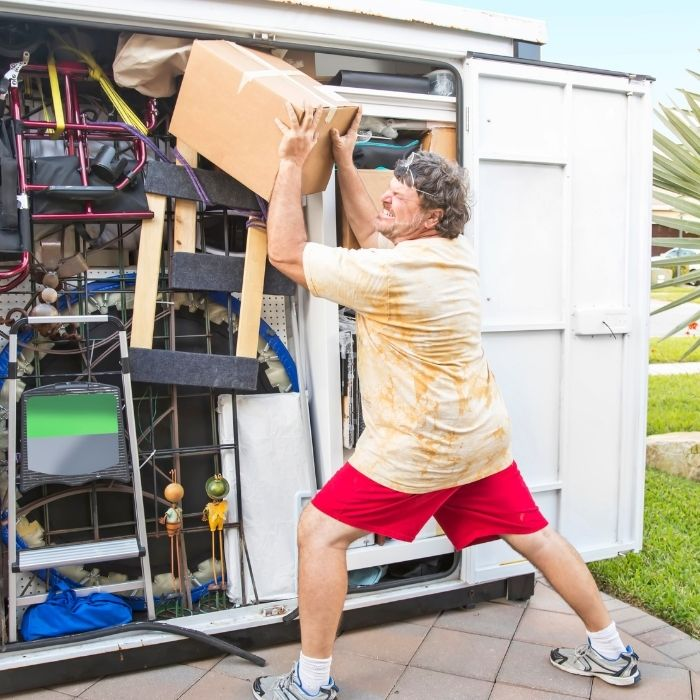 Stressed out man moving his possessions